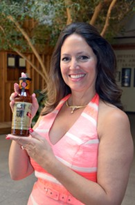 Carol Hefner with a bottle of Gaucho Sauce (photo provided)