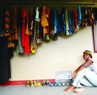 Kevine Kagirimpundu, one of this year's featured designers at the JEWEL Fashion Show sits next to some of her products. - PROVIDED