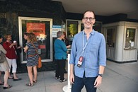 Brian Herndon outside the OCMOA with a line of people waiting to attend the screening of Rolling Papers during the DeadCenter Film Festival, 6-11-2015.  Mark Hancock