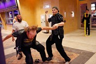 """Member of opposing Satanic groups fight outside a movie theatre following a showing of """"The Real Enemy"""" during the DeadCENTER Film Festival at Harkins Theatre in Oklahoma City, Thursday, June 11, 2015. - GARETT FISBECK"""