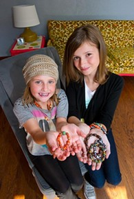 Allyson and Elizabeth Grantham with jewelry made of beads from Africa. - SHANNON CORNMAN
