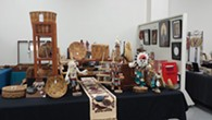 Art dealer selling vintage Native American baskets and drums - Uploaded by cedarwaxwing