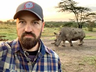 Author Sam Anderson in Kenya in front of one of the world's last two surviving Northern White rhinos. - Uploaded by Sundra Flansburg