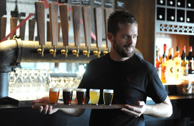 A beer flight makes its way to a thirsty customer (photo
