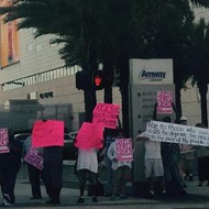 Amway or the highway: Rick Scott greeted with protest at latest Orlando fundraiser