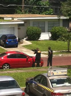 cops-pointing-rifle2-e1377625147297jpg