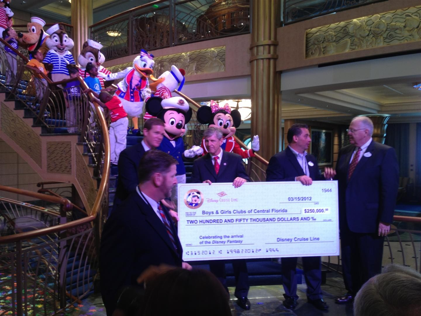 DCL president Karl Holz presents a $250,000 donation to Gary Cain, president of Boys and Girls Clubs of Central Florida (3/12/12)