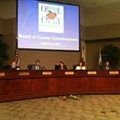 Flowers for the Dead: Democracy's demise at this morning's Orange County board meeting, WITH FLOWERS!