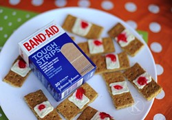 Graham crackers + white icing + strawberry jam = total gross-out.