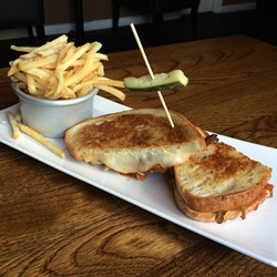 """Grilled cheese"" seems too simple a name for this concoction of roasted maitake mushrooms, melty Monterey jack cheese and sweet tomato jam."