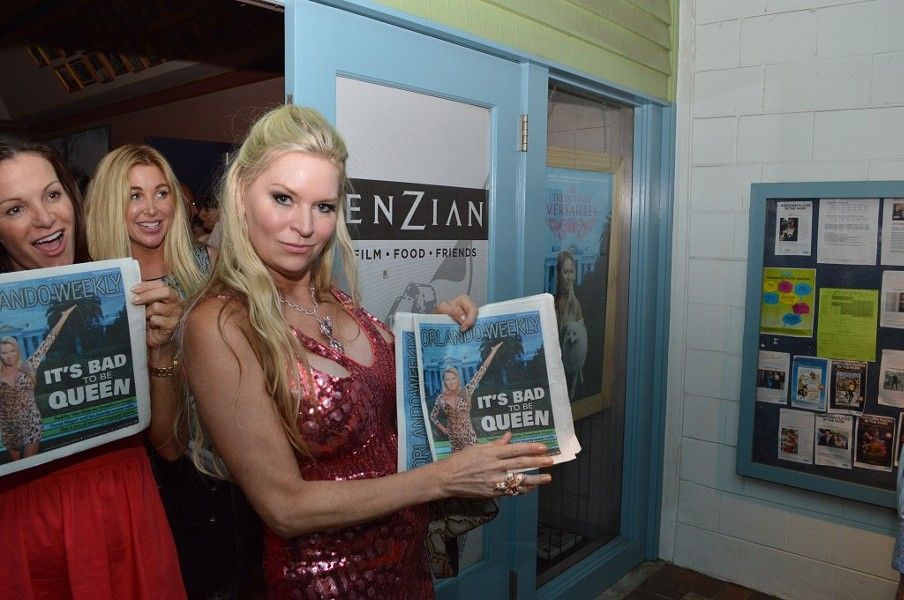 Jackie Siegel poses with a copy of Orlando Weekly at showing of 'Queen of Versailles' at the Enzian.