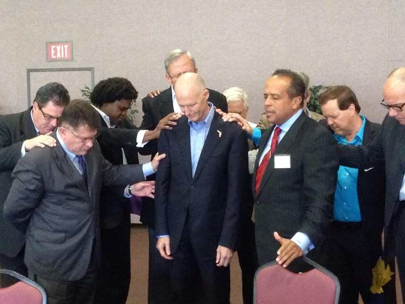 John Stemberger and friends pray on Rick Scott, via Facebook.
