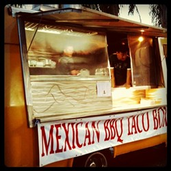 Mexican BBQ Taco Box food truck -- short yellow bus