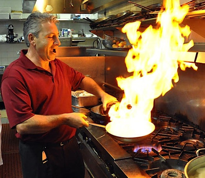 Denny Tornatore is not afraid of fire. - PHOTO VIA CAFFE POSITANO