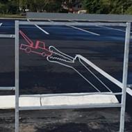 Photos: Local artist Chris Scala creates cheeky new public art in Mills 50