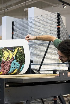 "Print on Demand: Jon Didier, an intern at Flying Horse Editions, examines Yuji Hiratsuka's ""Bewitching Ritual"" woodcut print as it comes off the press"