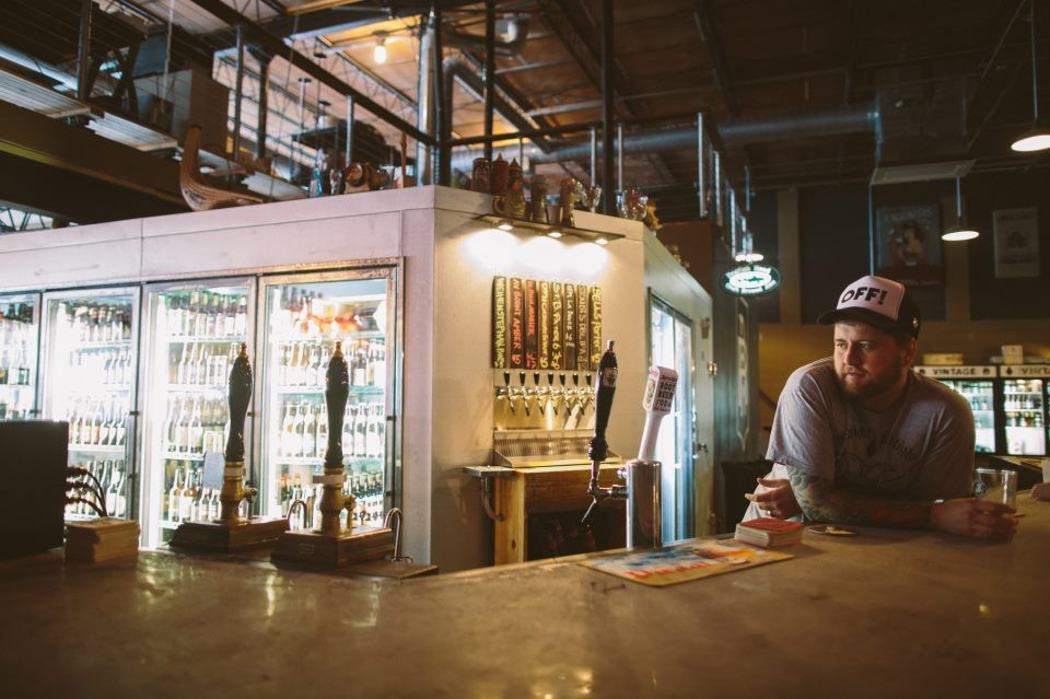 Redlight Red Light owner Brent Hernandez, mulling malts and drafts at the bar (Photo: Studio222 Photography)