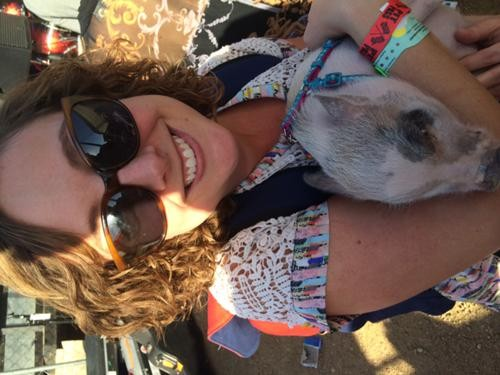 Shannon McGregor cuddles an adorable baby pig at SXSW 2014, Photo by Nick McGregor