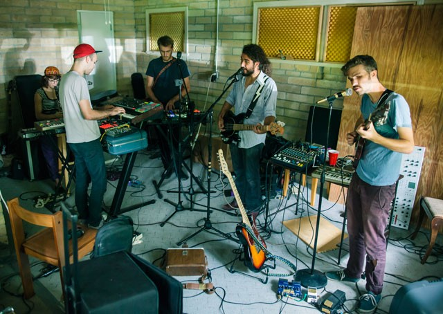 Sounding off: (from left) Amy Douglas, Tristan Whitehill, J.P. Wright, Gerald Perez, David Levesque and Alex Crook (off camera) practice in Crook's garage in Gainesville. - DANIEL DORSA