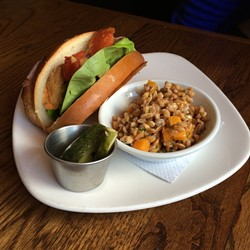 That killer fish sandwich came with a buttery/garlicky pumpkin-and-farro salad and house sweet-spicy pickles.