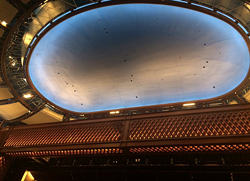 The Alexis and Jim Pugh Theater ceiling, featuring artwork by Tom McGrath.