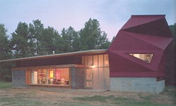 The Lucy House, designed and built by Samuel Mockbee's Rural Studio in 2002, reuses 7,000 cast-off carpet tiles.