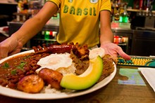 The meat of the matter: Kitschy futbol decor adds ambience; the menu focuses on many meats - JASON GREENE