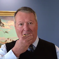 Here's Orlando Mayor Buddy Dyer eating a lemon
