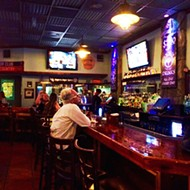 Downtown Pourhouse is an excellent place to meet up for shots or to grab a big, messy burger