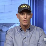 It's a good time to talk about Florida Sen. Rick Scott and that Navy hat