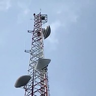 A man has climbed the TV broadcast tower at Orlando's WKMG channel 6