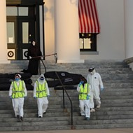 Protesters leave body bags on the steps of Florida's state capitol