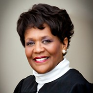 Florida judge says she was wrong to act as her son's attorney