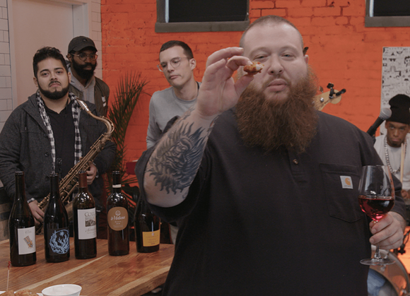 Action Bronson enjoying some crispy Korean-style Bonchon chicken - PHOTO VIA BONCHON