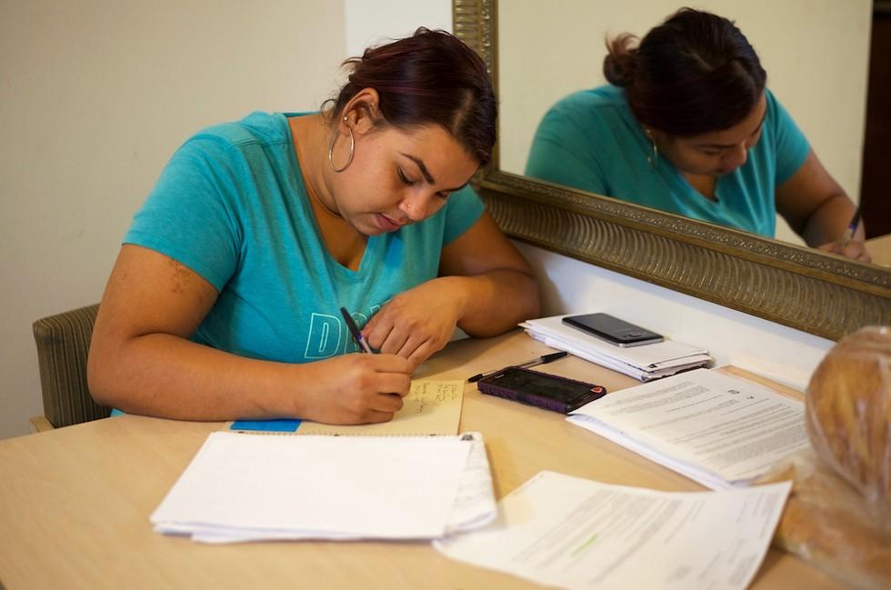 Desiree Torres navigates through the web of evacuee resources - PHOTO BY MONIVETTE CORDEIRO