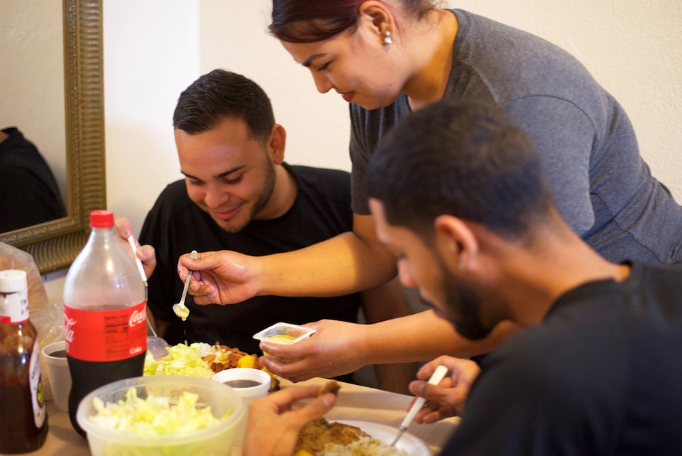Desiree Torres serves her friends a traditional Puerto Rican meal - PHOTO BY MONIVETTE CORDEIRO