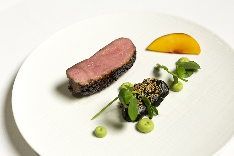 Duck breast with mole negro, Norman's - PHOTO BY ROB BARTLETT