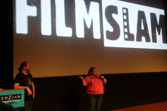 Enzian Programming Coordinator Tim Anderson and FilmSlam Producer Jen Vargas address attendees at a 2015 Slam. - CAMERON MEIER