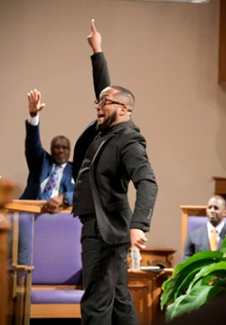 St. Mark AME Church Minister of Music Jeremiah Moore leads the choir. - PHOTO BY MONIVETTE CORDEIRO