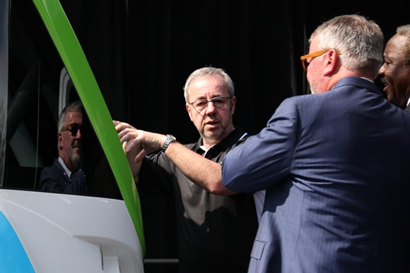 NAVYA CEO Jerome Rigaud explains AUTONOM to Orlando Mayor Buddy Dyer and Orange County Mayor Jerry Demings. - PHOTO BY JOEY ROULETTE