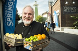 Chef Art Smith poses with fresh Florida produce to announce his farm-to-fork restaurant, Homecoming: Florida Kitchen and Southern Shine, opening summer 2016 at Disney Springs. - PHOTO VIA WALT DISNEY WORLD