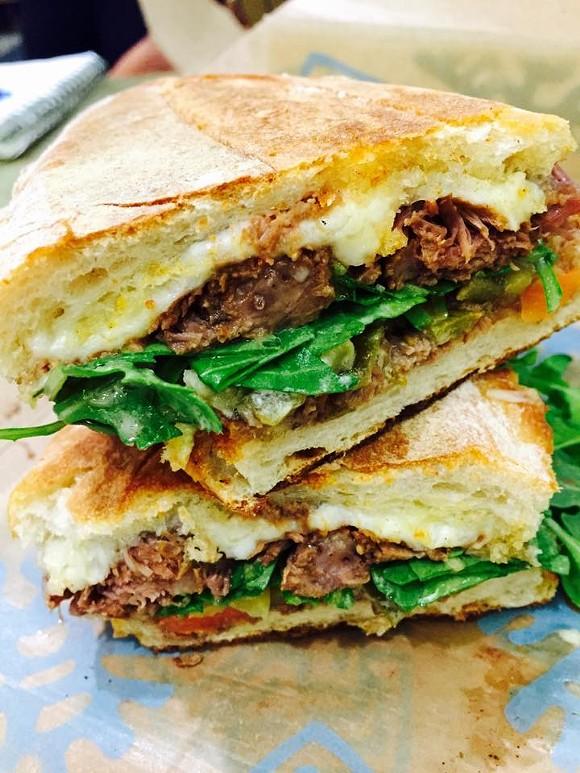 Pepito with braised beef short rib, artisan jack cheese, picked jalapeños and arugula. - PHOTO VIA FRONTERA FRESCO ON FACEBOOK