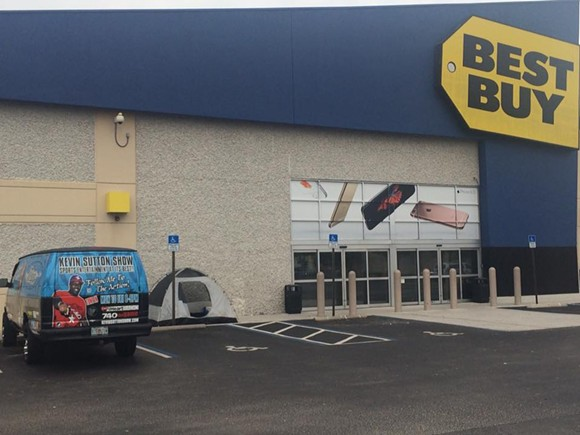Sutton and his van camped out in front of Best Buy. - PHOTO VIA FACEBOOK