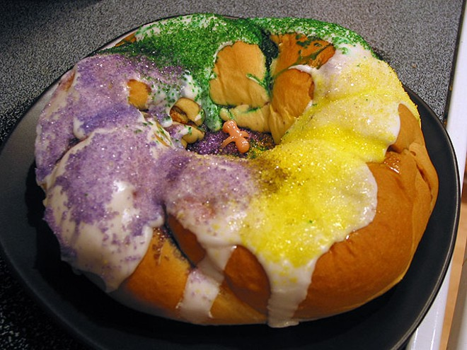 The classic purple, yellow and green King Cake - IMAGE VIA WIKIMEDIA COMMONS