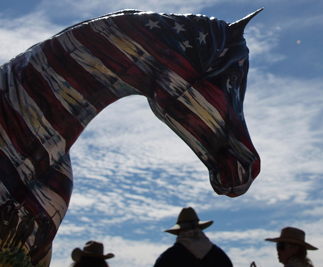 A hand-painted horse with the history of Florida and the Great - Florida Cattle Drive painted on it sits just outside the Silver Spurs - Arena. The horse, painted by Linda Ballantine Brown, was one of - the prizes in a raffle at the end of the drive.