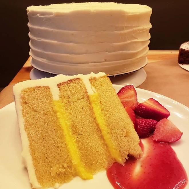 Lemon olive-oil cake with rosemary lemon curd and lemon mascarpone buttercream. I'll be having this cake for my birthday from now until I no longer have birthdays. - HOLLY V. KAPHERR
