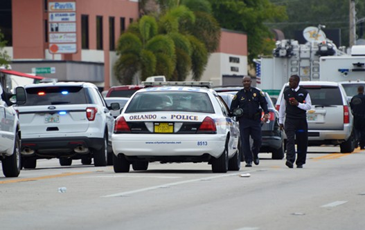 Law enforcement close street leading to Pulse nightclub as they investigate mass shooting. - PHOTO BY MONIVETTE CORDEIRO