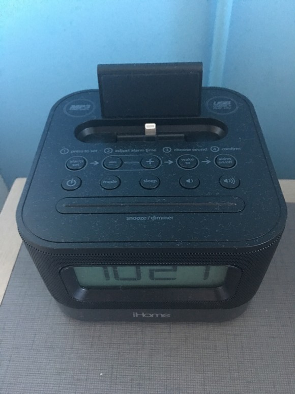 iHome clock radios with built-in Lightning iPhone docks next to the beds.
