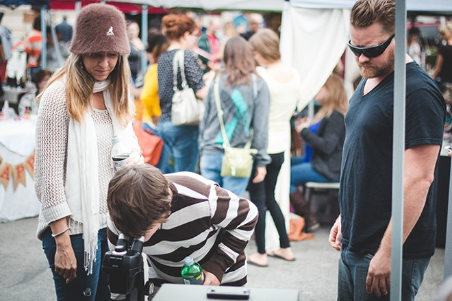 Shoppers at Grandma Party Bazaar in 2013 - PHOTO BY JAMES DECHERT
