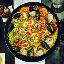 Seafood paella at Tapa Toro. - HOLLY V. KAPHERR